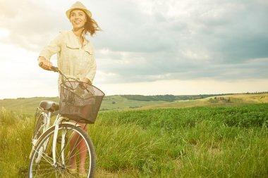 vintage girl next to bike