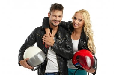 motorcyclists couple with helmets