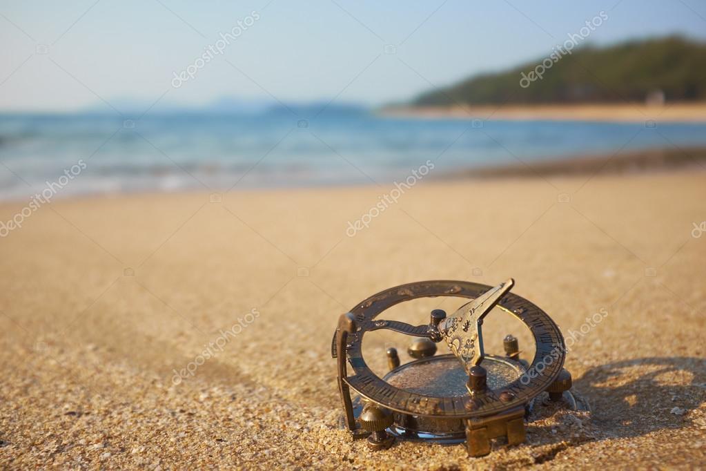 beach with vintage sundial