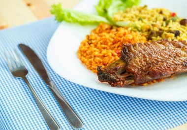 Dish from turkey meat with rice and salad leaves