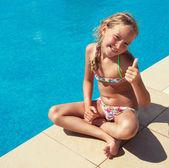 Fotografie Šťastné dítě v bazénu