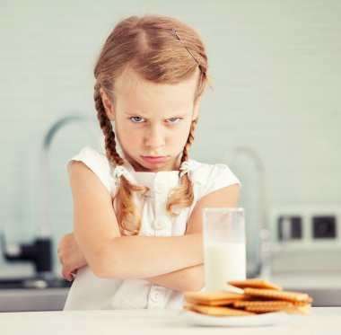 Child looks with disgust for food
