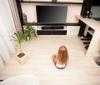Child watching TV at home