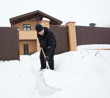 Man cleans snow shoveling