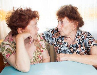 Two seniors woman talking