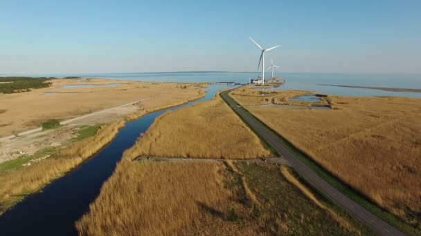 4k aerial view with blue river fields road and turning wind