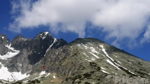 Time-lapse: The lift on the Lomnicky stit in High Tatras. Tatra Mountains, Tatras or Tatra, are a mountain range that form a natural border between Slovakia and Poland.