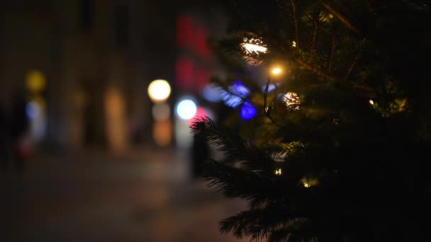 Christmas tree on the background of a winter city streets.