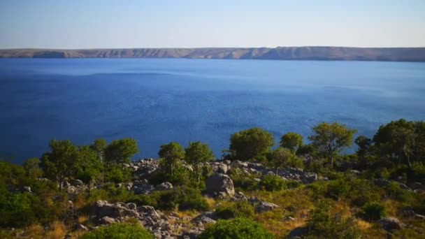 Croatian rocky coast on the Adriatic Sea on a sunny hot day.