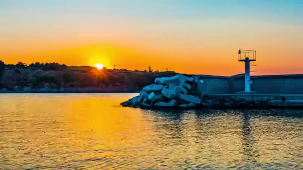 Timelapse: sunset in sea marina of Chernomorets. Chernomorets is a town on Black Sea coast of southeastern Bulgaria. Administratively part of Sozopol Municipality, Burgas Province, seaside resort.