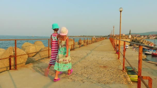 Two little beautiful girls walk in Tsarevo (Vasiliko, Michurin) is a town and seaside resort in southeastern Bulgaria, an centre of homonymous Municipality of Tsarevo in Burgas Province.