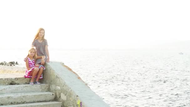 Two little beautiful girls walk in Nesebar is an ancient town and one of the major seaside resorts on the Bulgarian Black Sea Coast, located in Burgas Province.