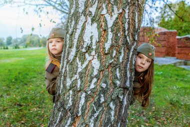small girls in Soviet military uniforms