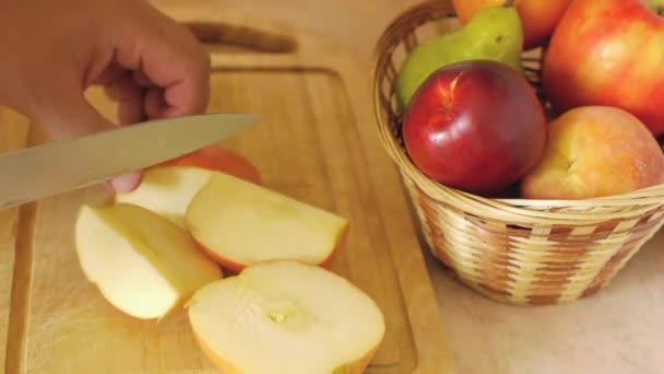 Woman cuts an apple knife