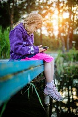 Little beautiful girl read e-books