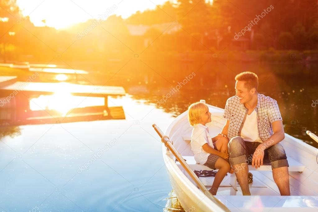 Dad and son in a boat
