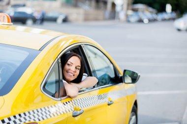 Beautiful woman in a taxi