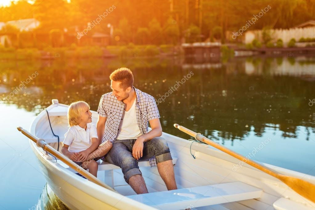 Dad and son in boat