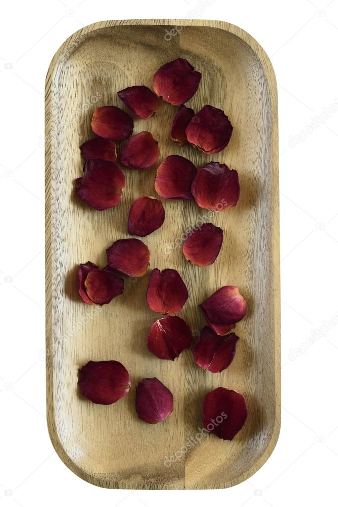 red rose petals on wooden tray