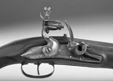 Antique French Flintlock Pistol in black and white.
