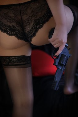 Sexy girl in lingerie with gun