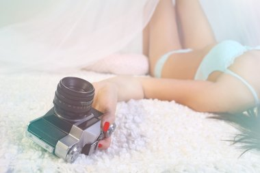 Pretty girl in lingerie with a camera in hand