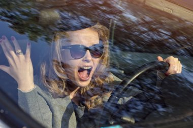 nerves behind the wheel - upset woman