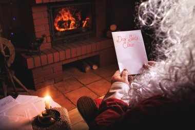 Santa Claus reads letters from children