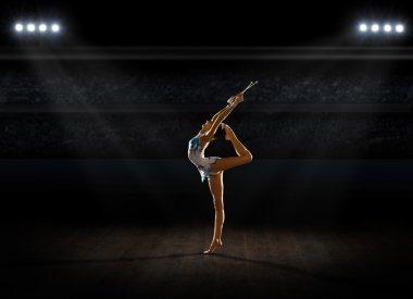 Girl engaged art gymnastic at sports hall