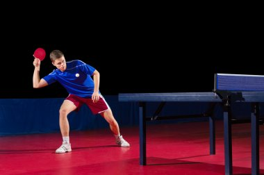 Table tennis player isolated