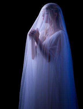 Praying young girl isolated