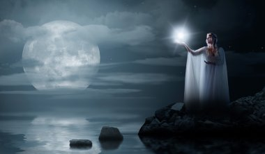 Elven girl with star isolated on sea coast