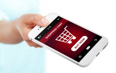 hand holding mobile phone with  shopping cart isolated over whit