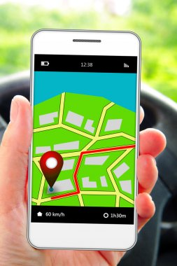Mobile phone in man's hand with gps application