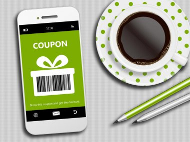 mobile phone with spring discount coupon, coffee and pencils