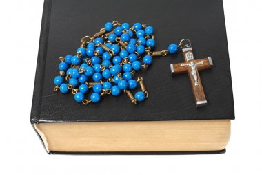 Blue rosary and black holy bible isolated on white background. stock vector