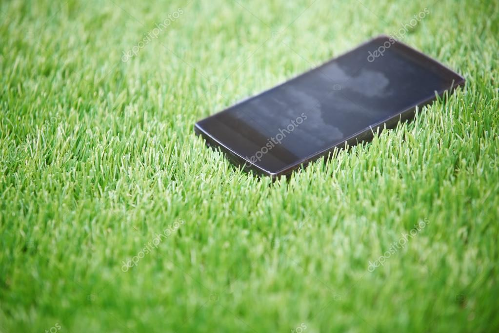 Smartphone in the grass