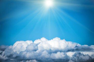 White clouds and bright sun