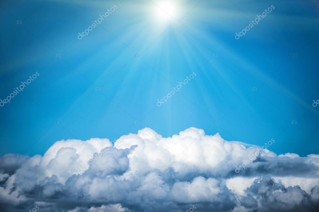 White clouds and bright sun