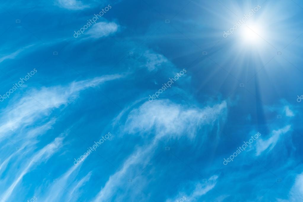 Blue sky, sun and white clouds
