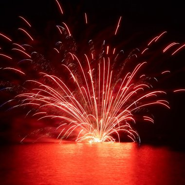 Red holiday fireworks on the lake