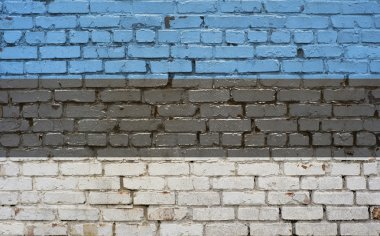 Flag of Estonia painted on brick wall, background texture