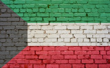 Flag of Kuwait painted on brick wall, background texture