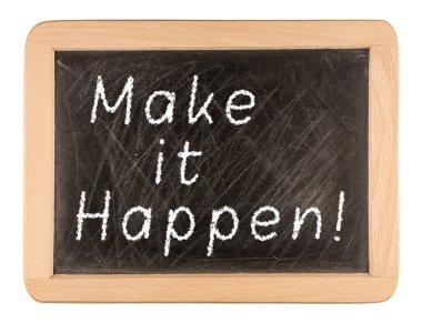 Make It Happen written in chalk on a used blackboard. Used in bu