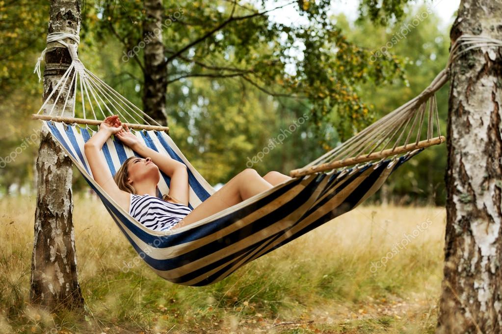 Young blonde woman resting on hammock — Stock Photo © piotr_marcinski  #102833264