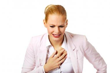 Young business woman having heart disease