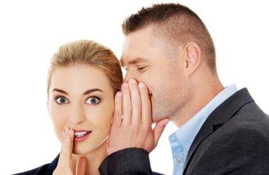 Men whispering secret to his friend