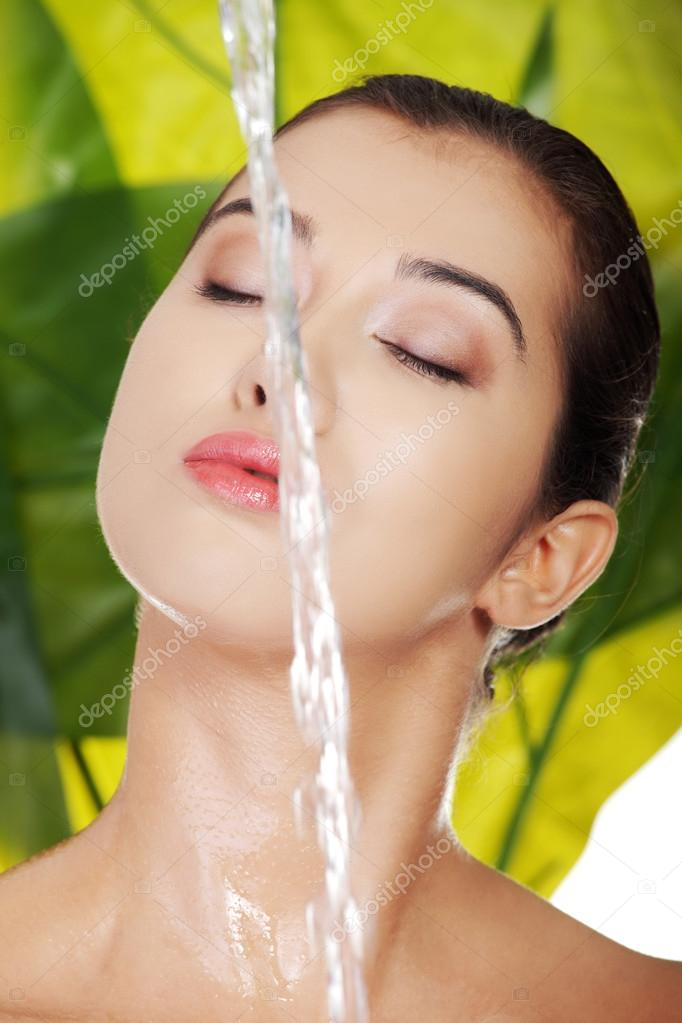 Womans face with water splash