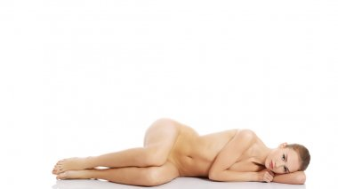 Sexy fit naked woman lying down