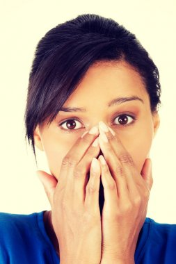 Young scared woman covering the mouth